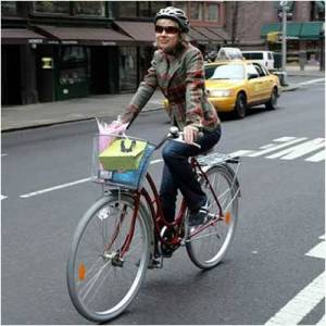 Cute woman riding a bike with a basket.