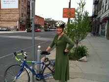 Barb on a bike wearing a green dress