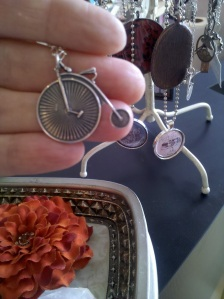 Cute silver penny farthing bike necklace.