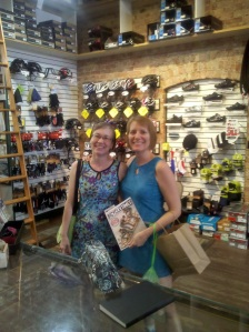 Belles and Baskets founder Betsy Lawrence, left, and Barb Chamberlain pick up a copy of Bicycling Times at Two Wheel Transit.