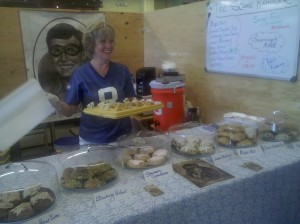 Woman holding scones at The Scone Ranger, Spokane Public Market