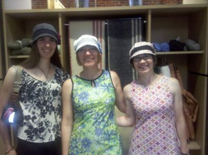 Rachel Scrudder, Barb Chamberlain, and Betsy Lawrence model hats made of recycled fabric by Old Man's Pants, available at Sun People Dry Goods, Spokane.