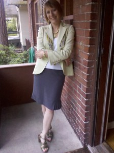 Barb Chamberlain in a gray skirt, white tank, green jacket, and green sandals. A typical outfit for riding my bike.