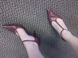 Burgundy T-strap stiletto heels.