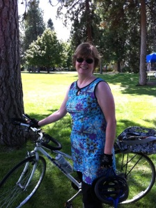 Wilma Flanagan wearing a Ruu-Muu and holding her bike. Spokane, WA