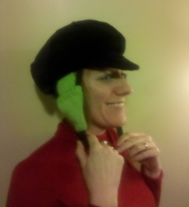 Bike helmet with black velvet cover, green knitted ear warmer/strap cover.