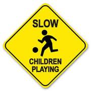 Traffic sign: Slow--children playing