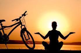 Sunset with bike and person doing yoga